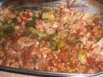 Hæld grøntsagerne i et smurt ovnfast fad.