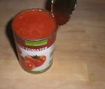 Tilsæt flåede tomater...