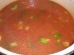 Tilsæt tomater og bouillon.