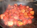 Vend jordbærrene på panden.