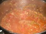 Tilsæt flåede tomater.