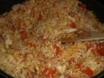 Tilsæt ris og tomat.
