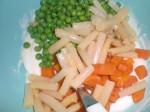 Vend grøntsagerne i dressingen.