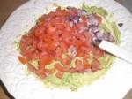 Tilsæt tomater og løg.