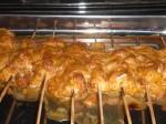 Steg kyllingespyddene i ovnen.