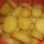 Lad kartoflerne dryppe af.